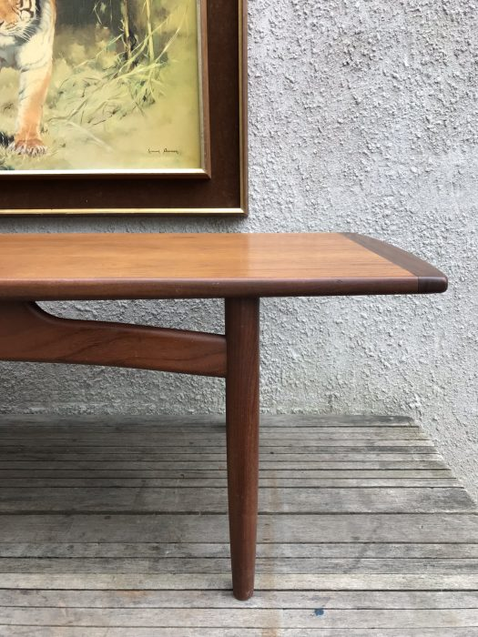 Mid Century 1960s E Gomme G Plan Teak Coffee Table This is a G Plan Long Coffee Table in teak c1968. A beautifully made table in attractive Teak timbers. The table top is veneered in a straight grained red toned teak with all edges finished in solid teak of a darker tone. The sides of the table are straight and the ends are curved, the edge strips widen to the centre of the table to give a tapering form. The top is supported on a solid teak stand with round tapering legs joined by curving rails. Condition, is very good, there are no repairs and no untoward patination. The top has been cleaned and waxed but the vintage condition is still as is. Measurements: H40cm x W137cm x D49cm Free Delivery within Cardiff. Delivery possible within 60 miles of Cardiff - please message for a quote. London / M4 corridor delivery possible please message. Collection preferred from CF11 9BZ - cash on collection. Happy to work a courier of your choosing/ organising.
